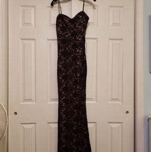 New w/tags Black lace evening gown with skintone